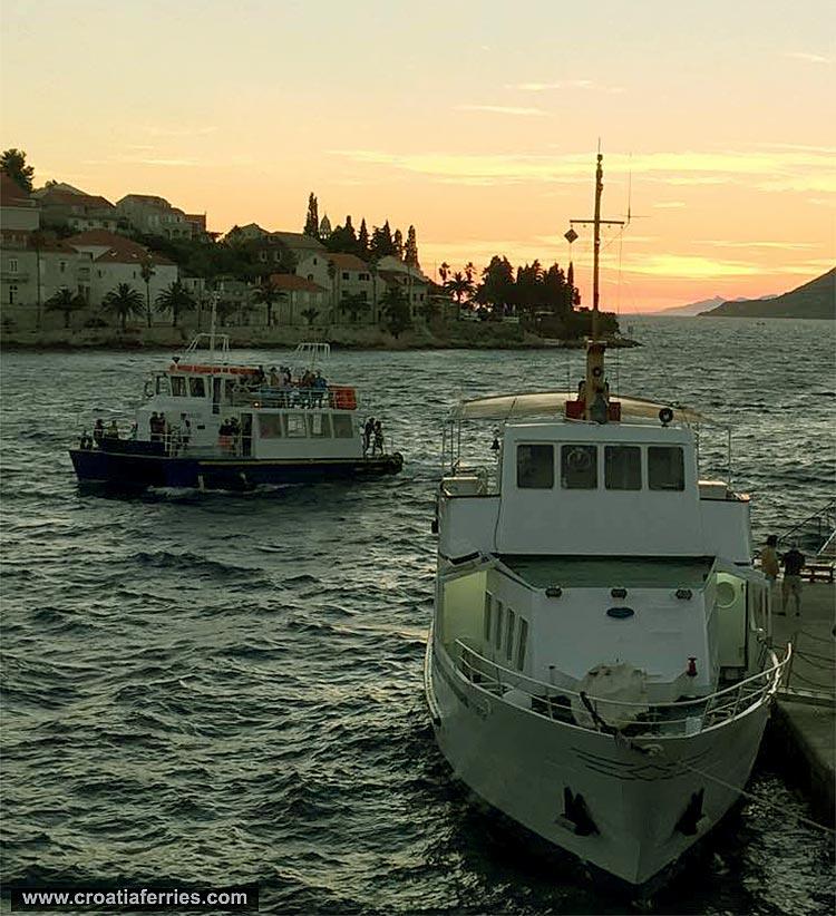 Foot passenger ferries in Adriatic sunset, summer 2016